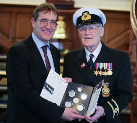 MERCHANT NAVY SEAMEN'S ROLE IN BATTLE OF ATLANTIC HONOURED ON HQS WELLINGTON